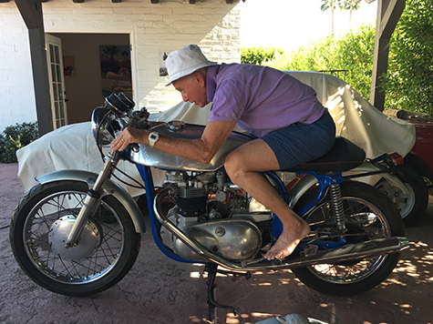 Billy Al Bengsten on one of Mark Bautzer's vintage bikes at Small House, Craig Krull Gallery's Pop-Up Show in Palm Springs, 2016