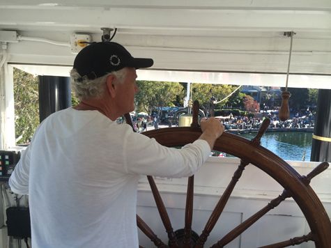 Craig Krull steering the Mark Twain Riverboat at Disneyland, 2015
