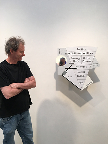 Artist Greg Colson and his piece, Onion Model of Personal Growth, installed in his exhibition, Model of Integrity, 2017