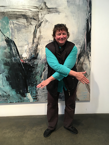 Artist Jenny Okun in front of Tom Lieber's painting Night in Day, 2016