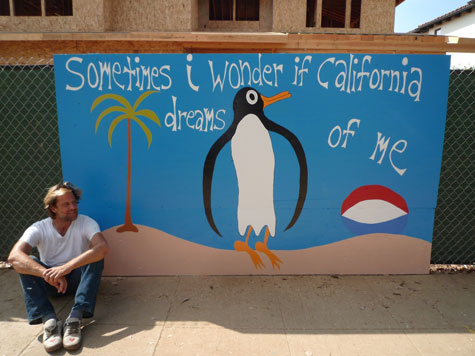 Michael Deyermond and one of his California murals